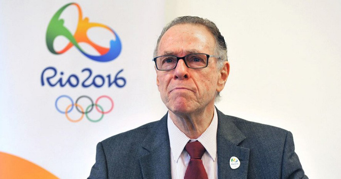 Carlos Nuzman_in_front_of_Rio_2016_logo_and_wearing_pin_badge