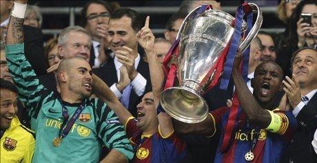 Eric Abidal_lifts_Champions_League_trophy_Wembley_May_2011_resized