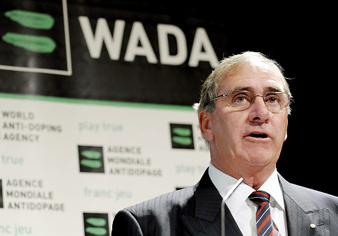 John Fahey_in_front_of_WADA_logo_Lausanne