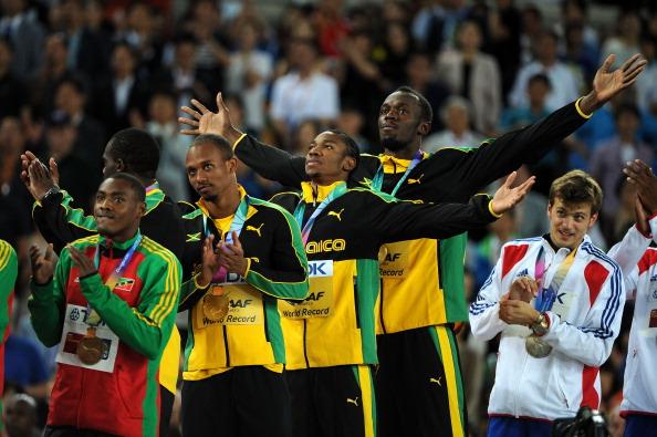 Usain Bolt_on_medal_stand_Daegu_2011
