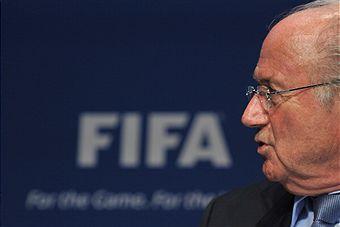 Sepp Blatter_looking_surprised_in_front_of_FIFA_logo