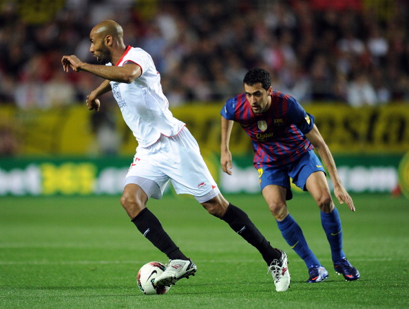 Frederic Kanoute_and_Sergio_Busquets_03-04-12