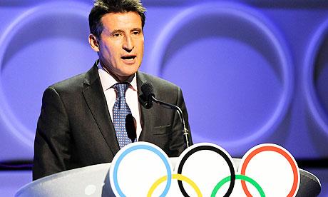 Sebastian Coe_behind_Olympic_rings
