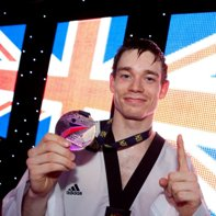 Aaron Cook_with_European_Championships_medal_May_6_2012