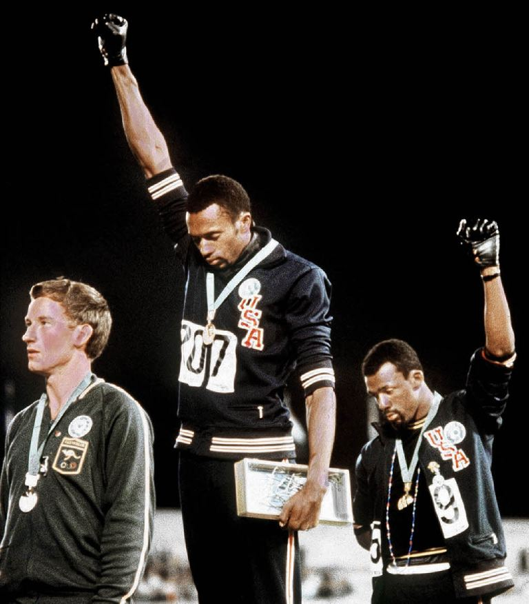 Tommie Smith_center_and_John_Carlos_right__21-05-12