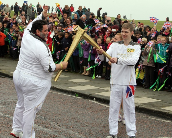 Bosco owner_carries_Olympic_Torch_June_2012