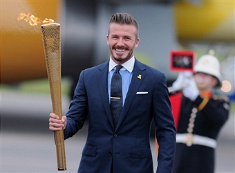 David Beckham_and_Olympic_Flame_June_23