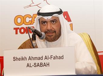 Sheikh Ahmad_Al-Fahad_Al-Sabah_behind_name_badge_and_microphone