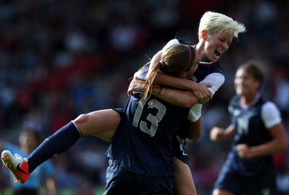 Alex Morgan_of_USA_is_congratulated_by_Megan_Rapinoe_after_scoring_during_the_Womens_Football_first_round_Group_G_Match