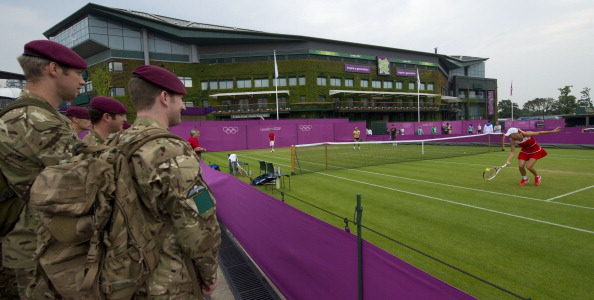 British soldiers_watch_Denmarks_Caroline_Wozniacki_during_her_training_session_at_Wimbledon_29-07-12