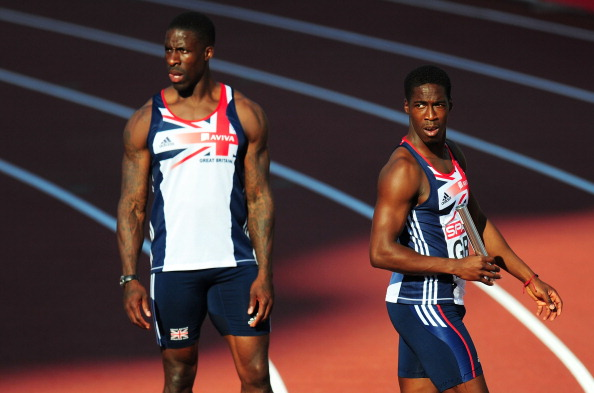 Dwain Chambers__Christian_Malcolm_of_Great_Britain_react_after_dropping_the_baton_in_the_Mens_4x100_Metres_Final_at_the_European_Athletics_Championships_Helsinki_2012