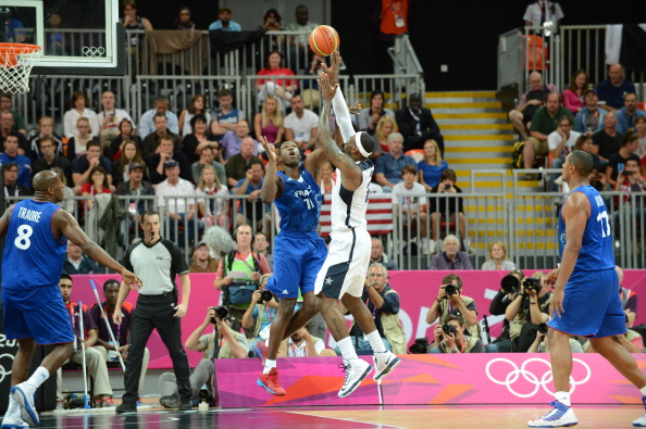 LeBron James_6_of_the_United_States_shoots_versus_Florent_Pietrus_11_of_France_at_the_Olympic_Park_Basketball_Arena_during_the_London_Olympic_Games_30-07-12