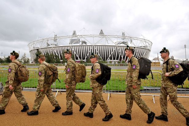 Army troops_walking_past_London_2012_Olympic_Stadium