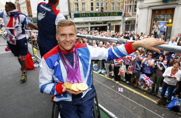 British quadruple_gold_medal_winning_Paralympian_David_Weir_shows_his_four_gold_medals_as_he_takes_part_in_the_London_2012_Victory_Parade_for_Team_GB_and_ParalympicGB_athletes