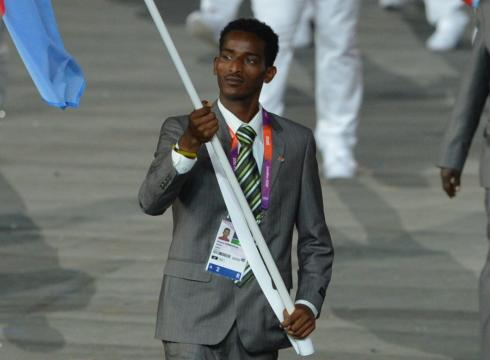 Eritrea flagbearer_Weynay_Ghebresilasie_leading_his_delegation_during_the_Opening_Ceremony_intends_to_seek_political_asylum_in_Britain