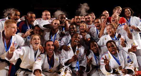French men_and_women_judo_team_celebrate_their_gold_medal_during_the_podium_ceremony_for_the_team_contest_at_the_Judo_World_Championships