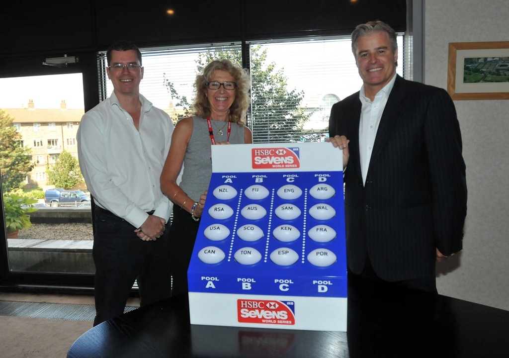 IRB Chief_Executive_Brett_Gosper_right_made_the_draw_for_the_Gold_Coast_Sevens_alongside_IRB_Sevens_Manager_Beth_Coalter_centre_and_adjudicator_Head_of_Rugby_World_Cup_Kit_McConnell_left