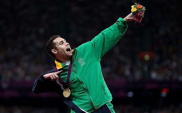 Jason Smyth_doing_Usain_Bolt_impress_receiving_200m_Londo_2012_September_6