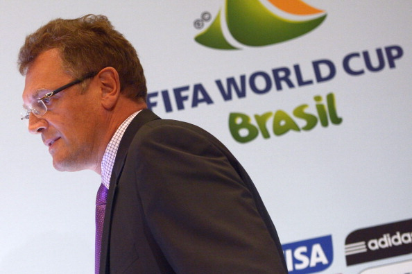 Jerome Valcke_in_front_of_Brazil_2014_logo_August_30_2012