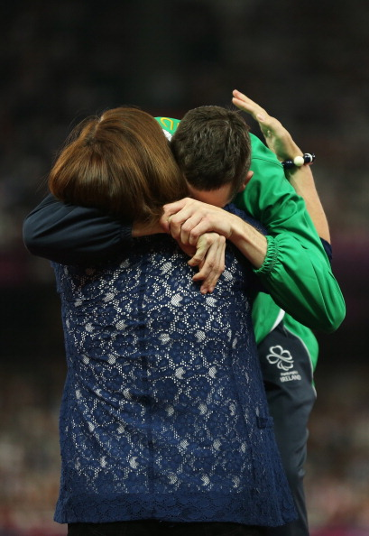 Michael McKillop_receives_London_2012_Paralympic_800m_gold_medal_from_mother