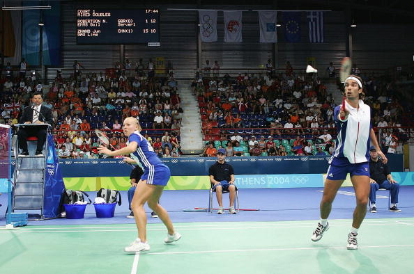 Nathan Robertson_hits_the_shuttlecock_behind_teammate_Gail_Emms_of_Great_Britain_against_Ling_Gao_and_Jun_Zhang_of_China_in_the_mixed_doubles_badminton_gold_medal_match_at_Athens_2004