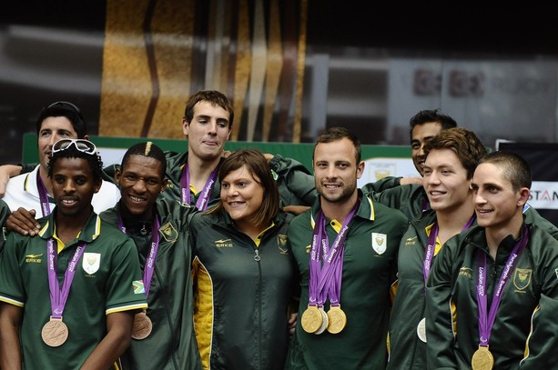 Oscar Pistorius_arrives_back_with_rest_of_South_African_team_from_London_2012_September_11