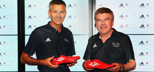 Thomas Bach_with_Herbert_Hainer_as_Adidas_renew_deal_with_DOSB