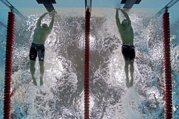 Chad le_Clos_R_of_South_Africa_touches_out_Takeshi_Matsuda_of_Japan_to_win_the_gold_medal_in_the_Mens_200m_Butterfly