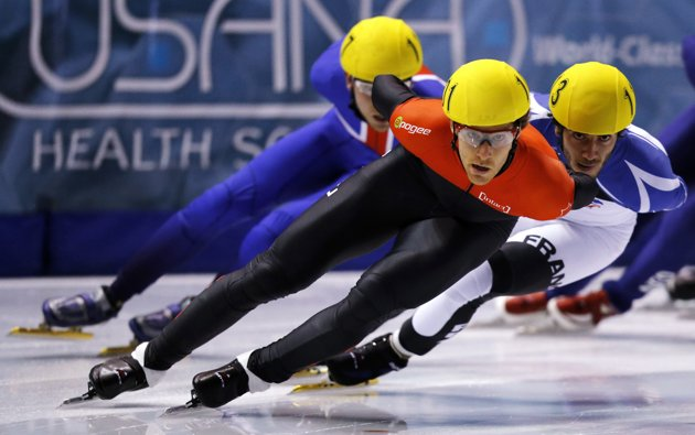 Olivier Jean_C_of_Canada_leads_Thibaut_Fauconnet_R_of_France_and_Jon_Eley_of_Great_Britain_in_the_mens_1000_meter_heats_during_the_ISU_Short_Track_World_Cup_competition