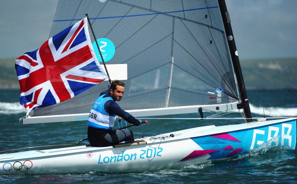 Ben Ainslie celebrates winning gold in the London 2012 Finn race