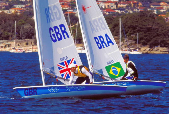 Ben Ainslie on his way to gold and Robert Scheidt sailing to silver in the mens open Laser fleet races at Sydney 2000