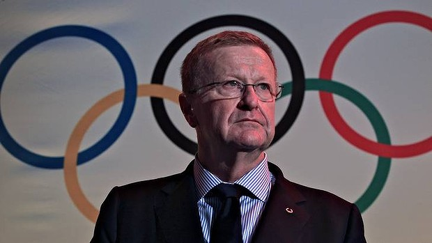 John Coates in front of Olympic rings