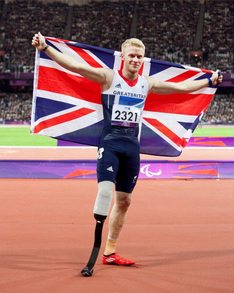 Jonnie Peacok with flag after winning London 2012