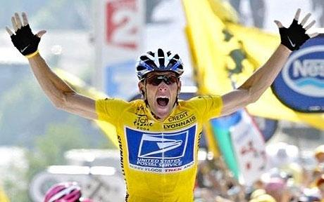 Lance Armstrong celebrating as he crosses the line