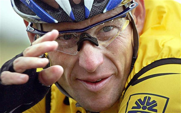 Lance Armstrong giving salute