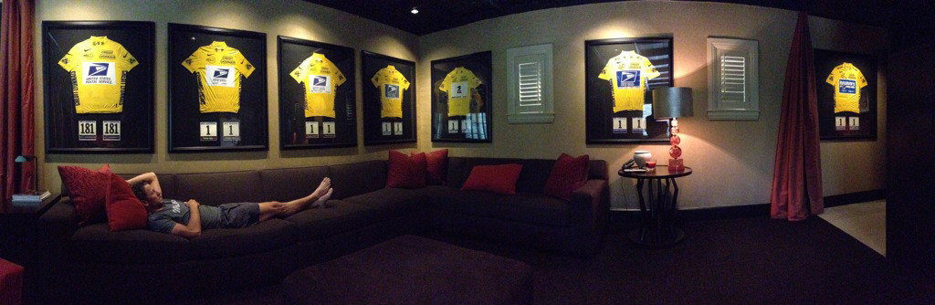 Lance Armstrong in room with yellow jerseys