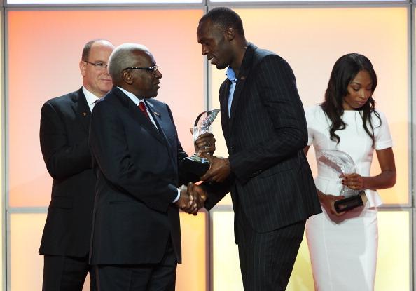 Usain Bolt receives award from Lamine Diack Monaco November 24 2012