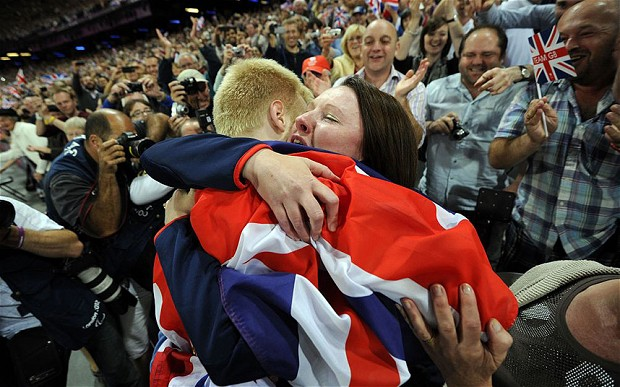 Jonnie Peacock celebrates winning 100m London 2012 with mother