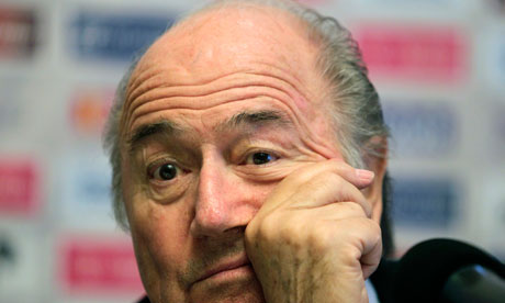 Sepp Blatter with hand on head