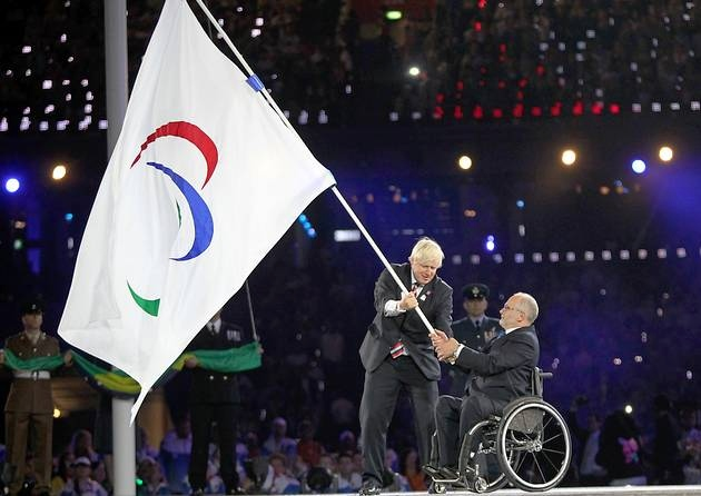 Sir Philip Craven at London 2012 Closing Ceremony with Boris Johnson and Paralympic flag