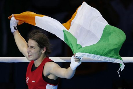 Katie Taylor with Irish flag after winning London 2012 medal