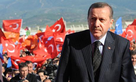 Recep Tayyip Erdoğan in front of Turkish flags