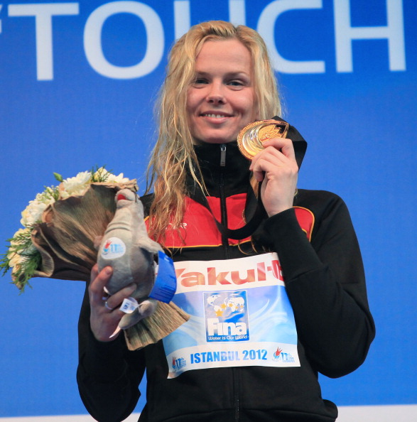 Britta Steffen poses with her gold medal after winning the womens 100m freestyle final