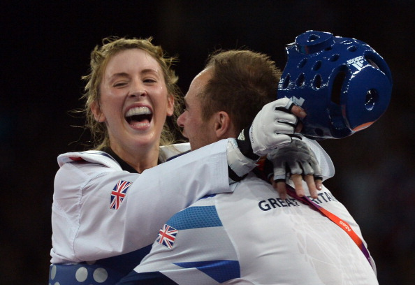 Jade Jones of Great Britain celebrates with coach