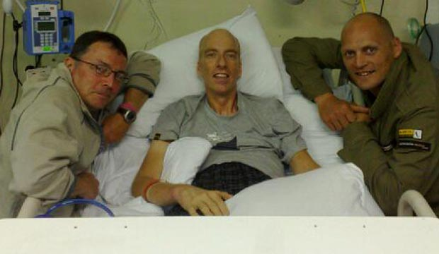 Simon Richardson in hospital bed after accident