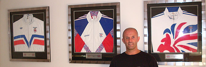 Simon Jackson in front of tracksuits