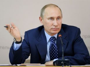 Vladimir Putin with pen