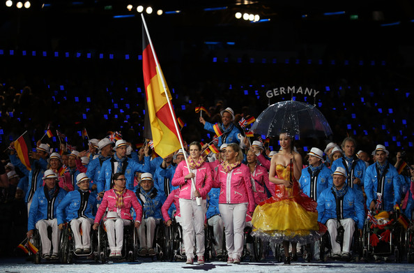Danielle Schulte carrying flag at London 2012