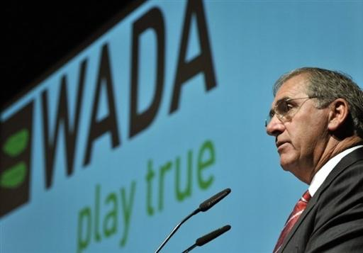 John Fahey in front of WADA logo