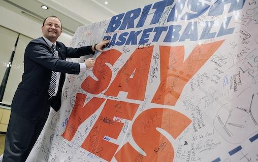 Patrick Baumann signing British Basketball banner